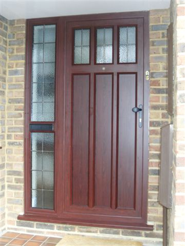 A Rosewood Aluminium Entrance Door manufactured my Micron Windows of Orpington