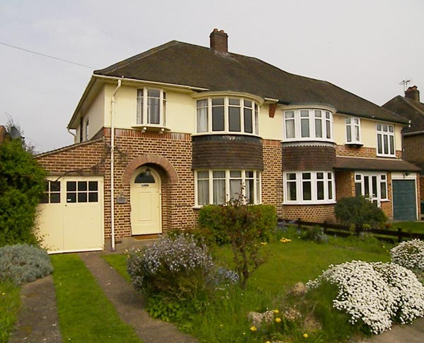 The typical British home.  Shown here totally original and the white pvc in the adjoining property
