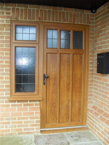This hand made wood effect aluminium entrance door demonstrates how superior powder coated windows are to pvcu