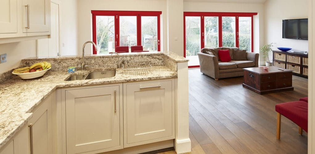 Polyester Powder Coating has transformed the use of colour in homes for example, such as these Red Origin Bifolding Doors