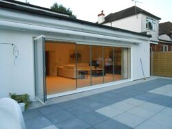 frameless slide and fold doors in new extension