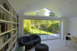 Frameless glass curtains feature no aluminium or framing between any of the doors