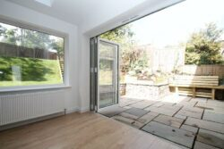 Picture of open bifolding doors.