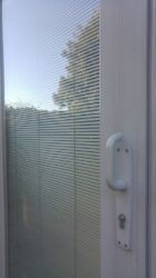 Old doors with integral blinds.